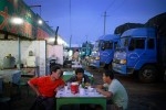 Truck drivers share a meal at a truck stop outside Turpan, China, 2007