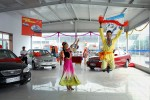 A couple performs a traditional dance in a car dealership outside Turpan, China, 2007. BYD, a new Chinese/Japanese family car was introduced for the first time in the city.