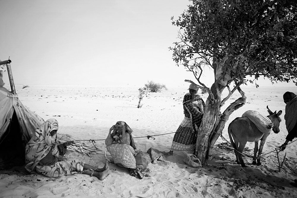 Women in the Oure Cassoni refugee camp close the border of Darfur, about 23 kilometers outside Bahai, Chad, 2007. About 27,000 people live in grim conditions after fleeing the violence in nearby Darfur.