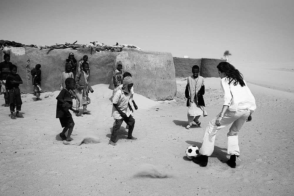 Angelina Jolie, the Oscar winning actress and UNHCR Goodwill Ambassador, plays soccer with children in a refugee camp. Angelina Jolie spent two days visiting Oure Cassoni, a refugee camp close to the Darfur border. Almost 27,000 refugees lives there and it was opened in 2004.