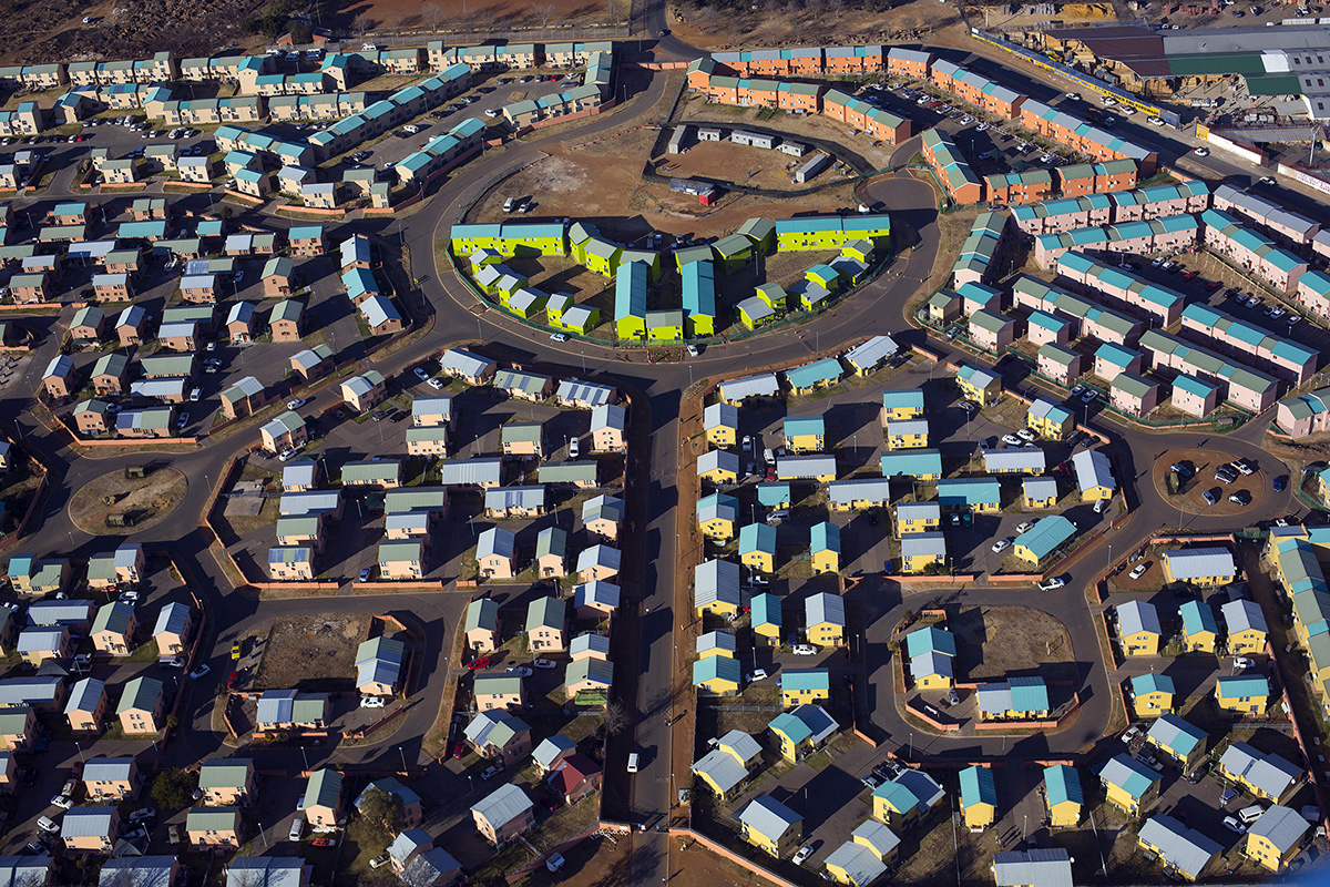 SOWETO, SOUTH AFRICA - JULY 19: An aerial view of newly constructed apartment complexes on July 19, 2018 in Kliptown section of Soweto, South Africa.  Soweto has seen some of the largest developments in infrastructure with shopping malls, public transport etc. South Africaís largest township is now almost self-sufficient whereas before the residents had to buy things in Johannesburg. (Photo by Per-Anders Pettersson/Getty Images)