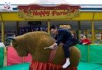 A Chinese businessman rides a mechanical bull at Windows Of the World Theme park in December 2008 in central Shenzhen, China.