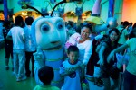 Performers greet children after a Disney themed show at Happy Valley Theme park in September 2008 in central Shenzhen, China. The park has various attractions such as roller coasters, water rides and Walt Disney style live shows for children.