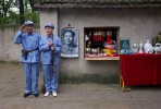 Chinese tourists dress up as Mao Tse-tung outside his house at the Zao'yuan Revolutionary Site Park in October 2008 in central Yan'an, China. The city has become a popular place for communist pilgrims, as it was the endpoint for the Long March and the center of the Chinese Communist revolution from 1935 to 1948. Chinese communists celebrate Yan'an as the birthplace of the revolution.