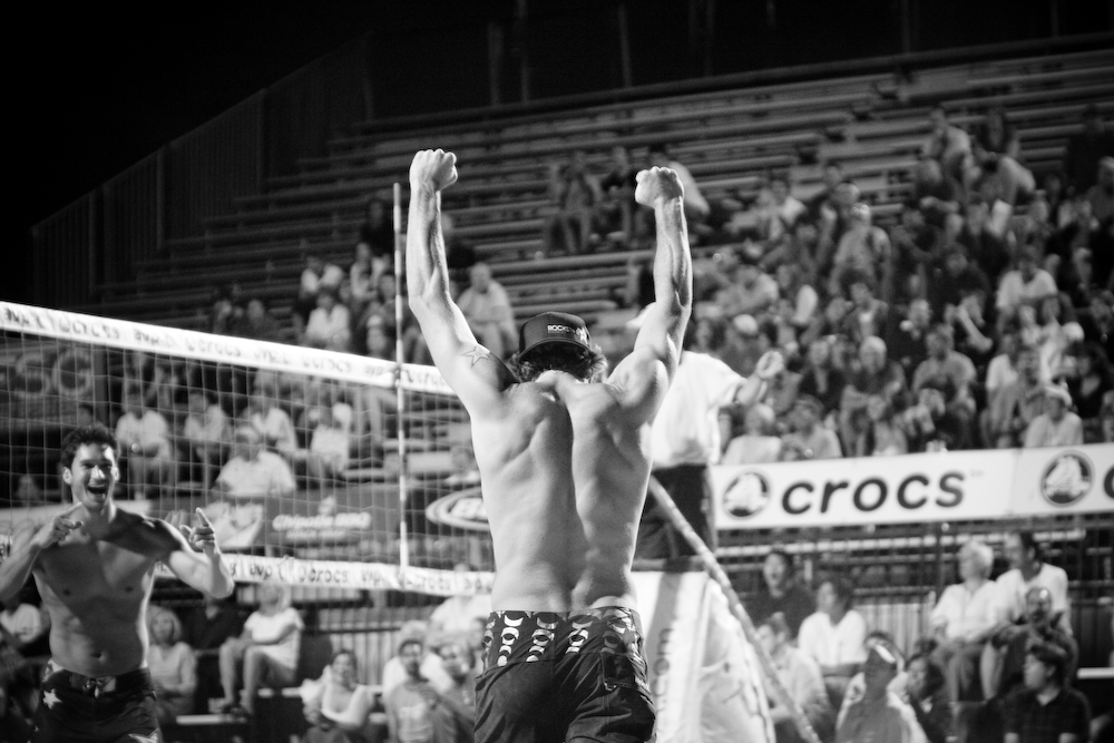 Aaron Wachtfogel throws up his arms after scoring a point as his partner Scott Wong cheers him on during the AVP tournament.