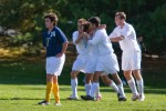 Tuft University teammates celebrate a goal again Trinity College.