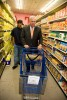 A Hyde Square Task Force youth leader and Boston Mayor Thomas Menino grocery shopping with a budget of $21, the average weekly amount allotted to food stamp recipients.