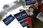 A college student braves the cold and holds a sign in support of presidential candidate Sen. John McCain (R-AZ).
