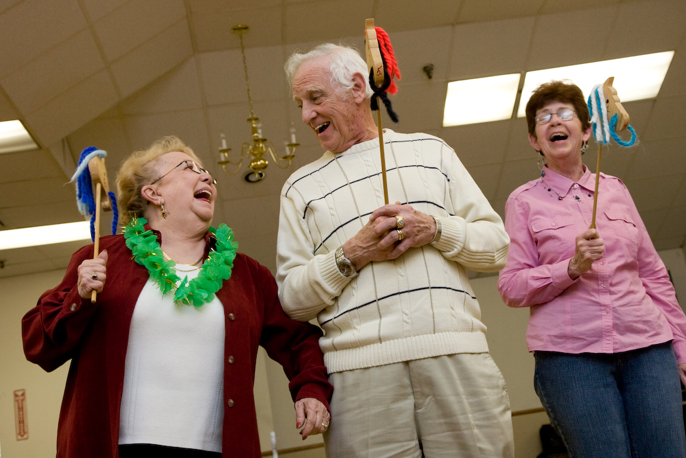 Senior citizens participate in a round of {quote}human horse racing{quote} at the Elks Club's annual dinner dance for seniors.