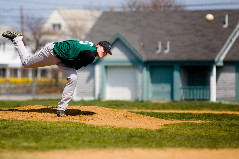 Throwing a pitch for Marshfield High.