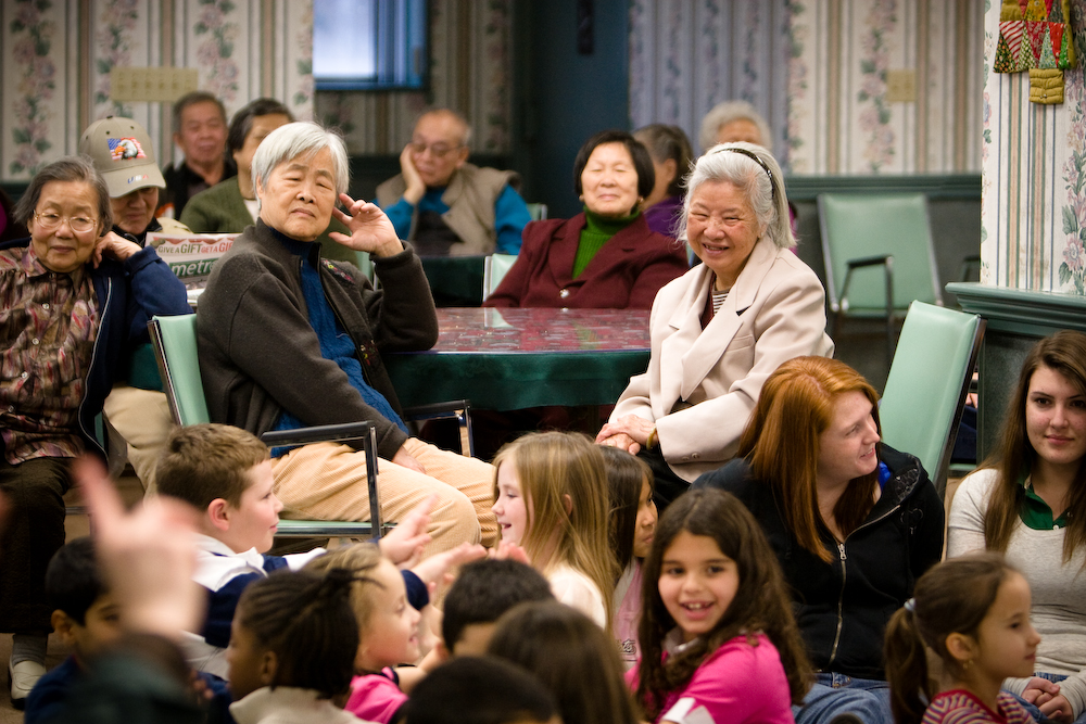 Young and old celebrate the holiday season together at the annual Germantown intergenerational holiday event.