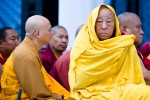 A Buddhist monk keeps warm during the visit of His Holiness the Dalai Lama to New England.