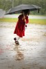 A young girl runs in the rain during Quincy Medical Center's annual cancer walk.