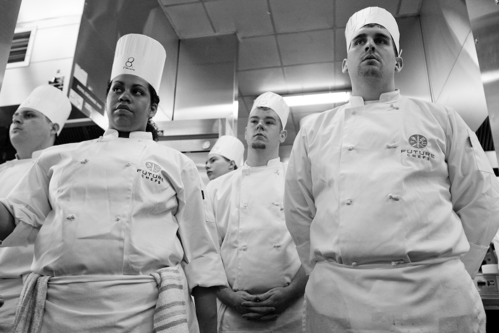 Students listen to the rules prior to the start of the Future Chefs Competition at Boston University.