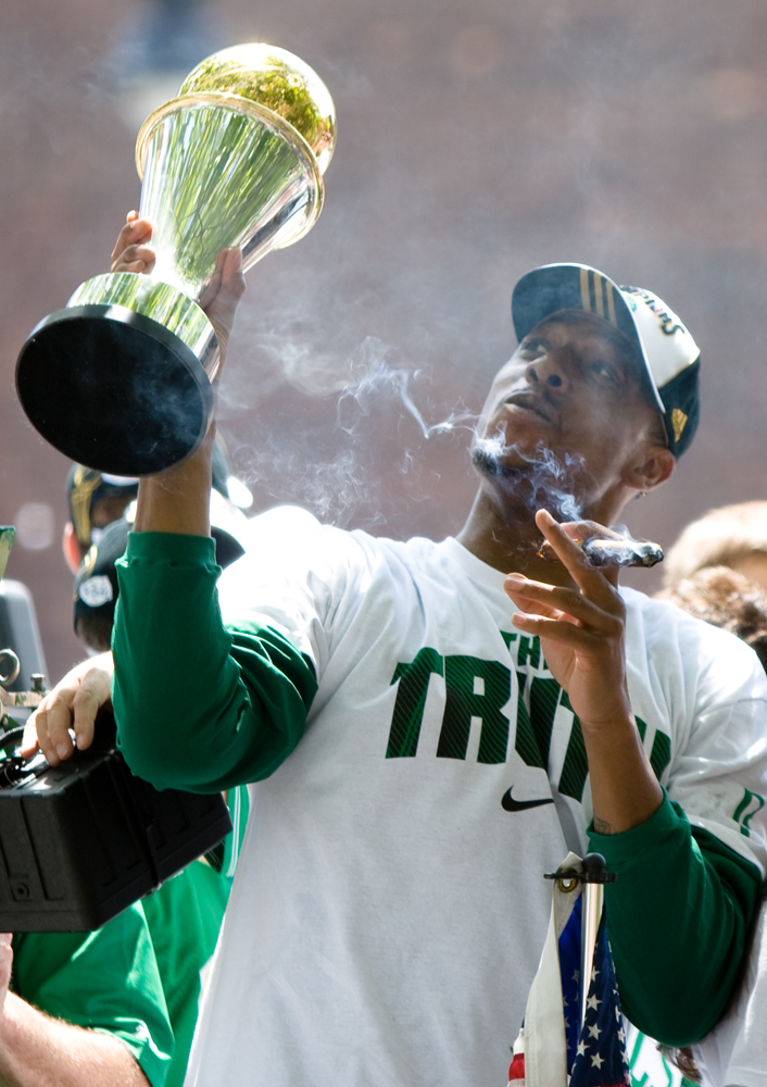 Celtics captain and NBA Finals' MVP Paul Pierce waves his world championship trophy.