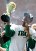 Celtics captain and NBA Finals' MVP Paul Pierce waves his world championship trophy.