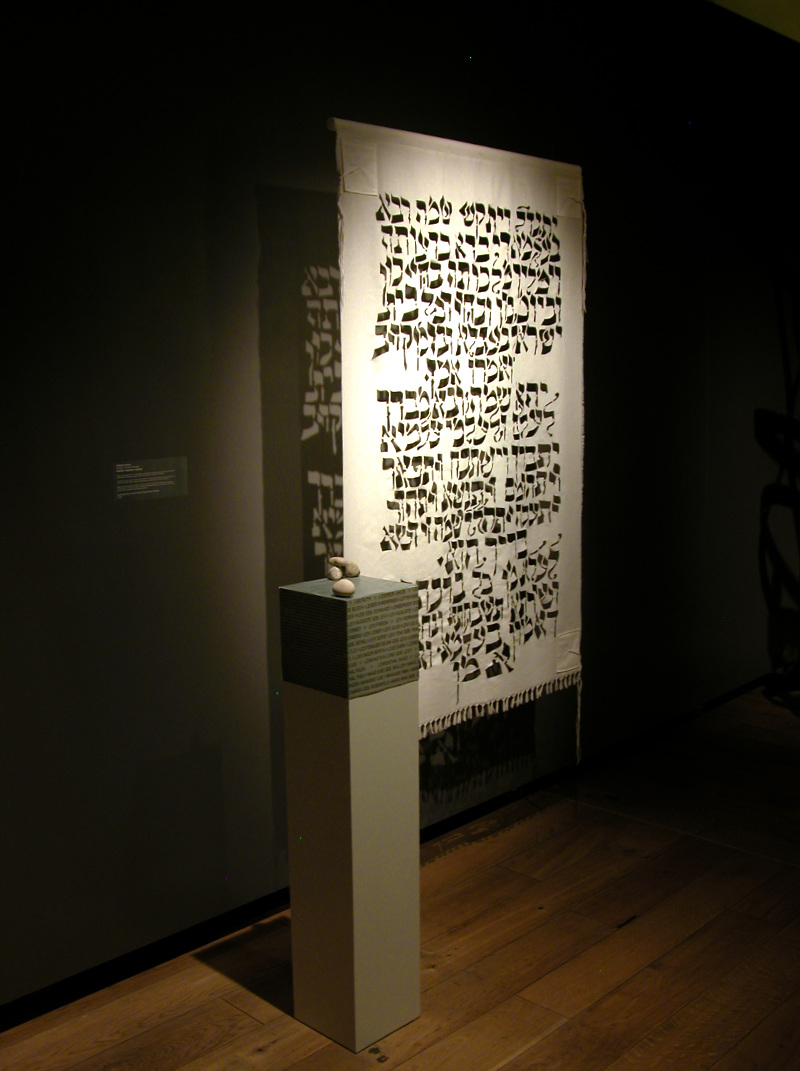 This piece was made during a residency in Latvia and is in the permanent collection of the Mark Rothko Center in Daugavpils.The Kaddish is an ancient prayer for the dead, and public recitation of it was forbidden during the Soviet occupation of Latvia.  The plinth has the Latvian transliteration of the prayer, and names of some of the Jews killed in WWll from this place.
