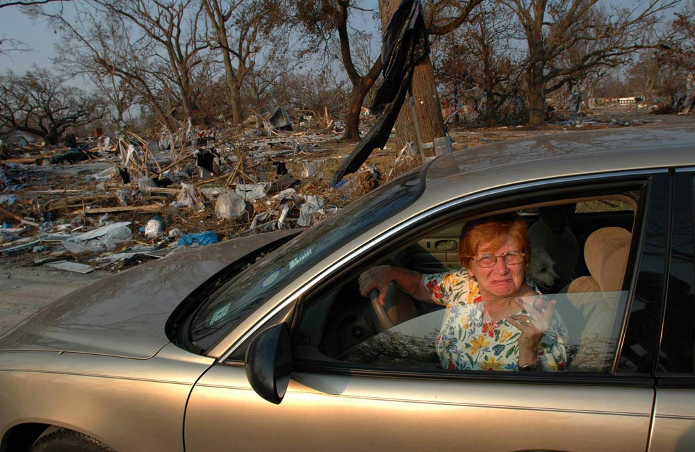 Judy Ladner searches for her home along Finley St in Gulfport nearly a week after Hurricane Katrina completely destroyed the neighborhood.