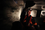 Jack Trackemas travels down the long corridors to the longwall mining site in a transport vehicle.