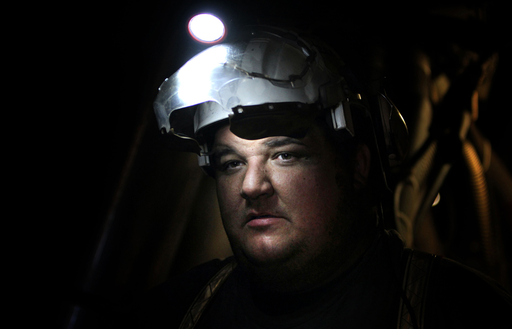 Dwight Harris operates the protective shields on the longwall mining machine.