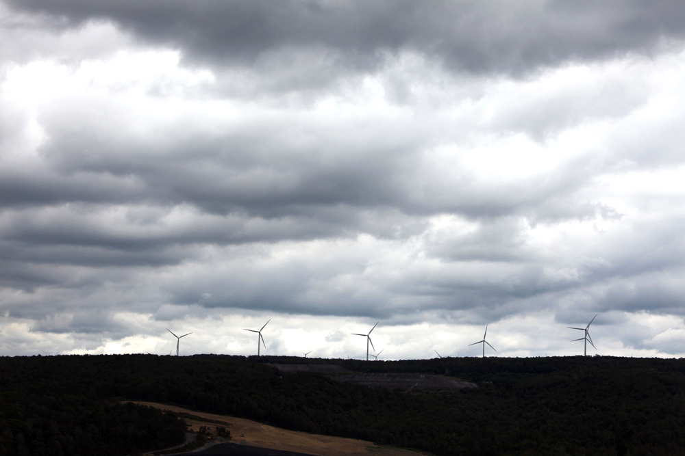Electric generating wind mills line a ridge above an Alpha Resources mining operation near Johnstown, Pa.  Although clean wind power is gaining popularity in Pennsylvania, it provieds only a fraction of the state's electricity needs.