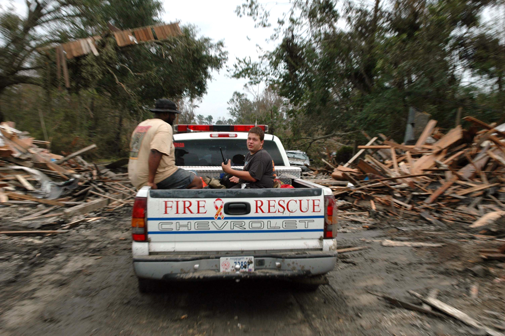 Firemen in Pearlington, MS patrol the streets where the eye of the storm passed.