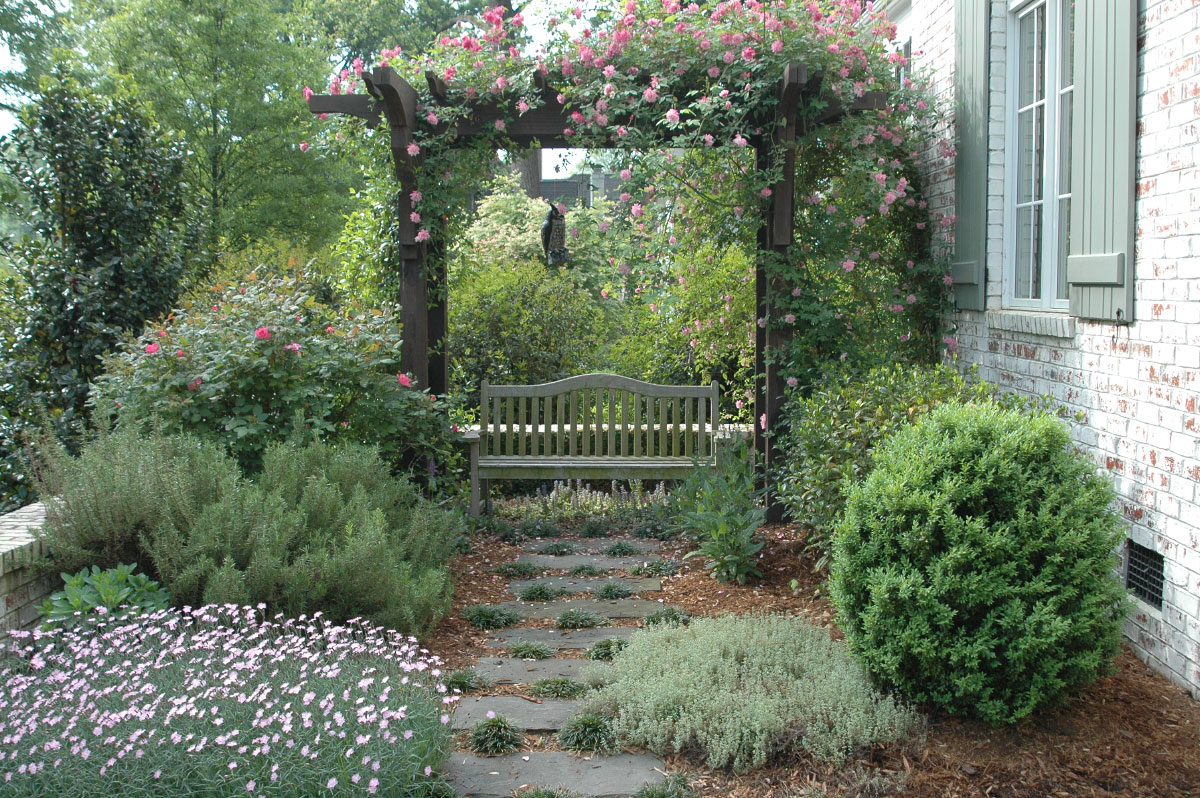 Located within the entry courtyard a romantic garden pergola with a bench nestled beneath beckons your contemplation. All the while dreamy dianthus and climbing roses serve asyour constant companions.