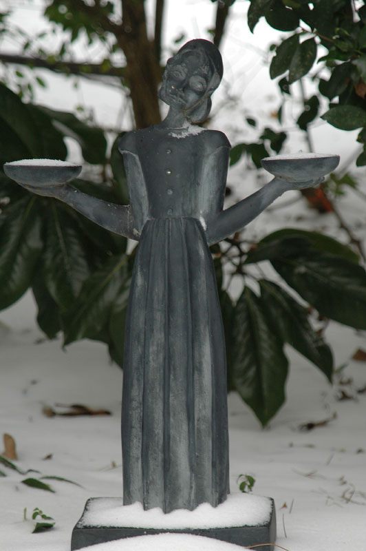 A statue of the beloved {quote}Savannah Bird Girl{quote} statue whose original sits in Savannah's Bonaventure Cemetary, made famous from John Berendt's {quote}Midnight in the Garden of Good and Evil{quote}, keeps watch over this lovely landscape and waits for spring to arrive.