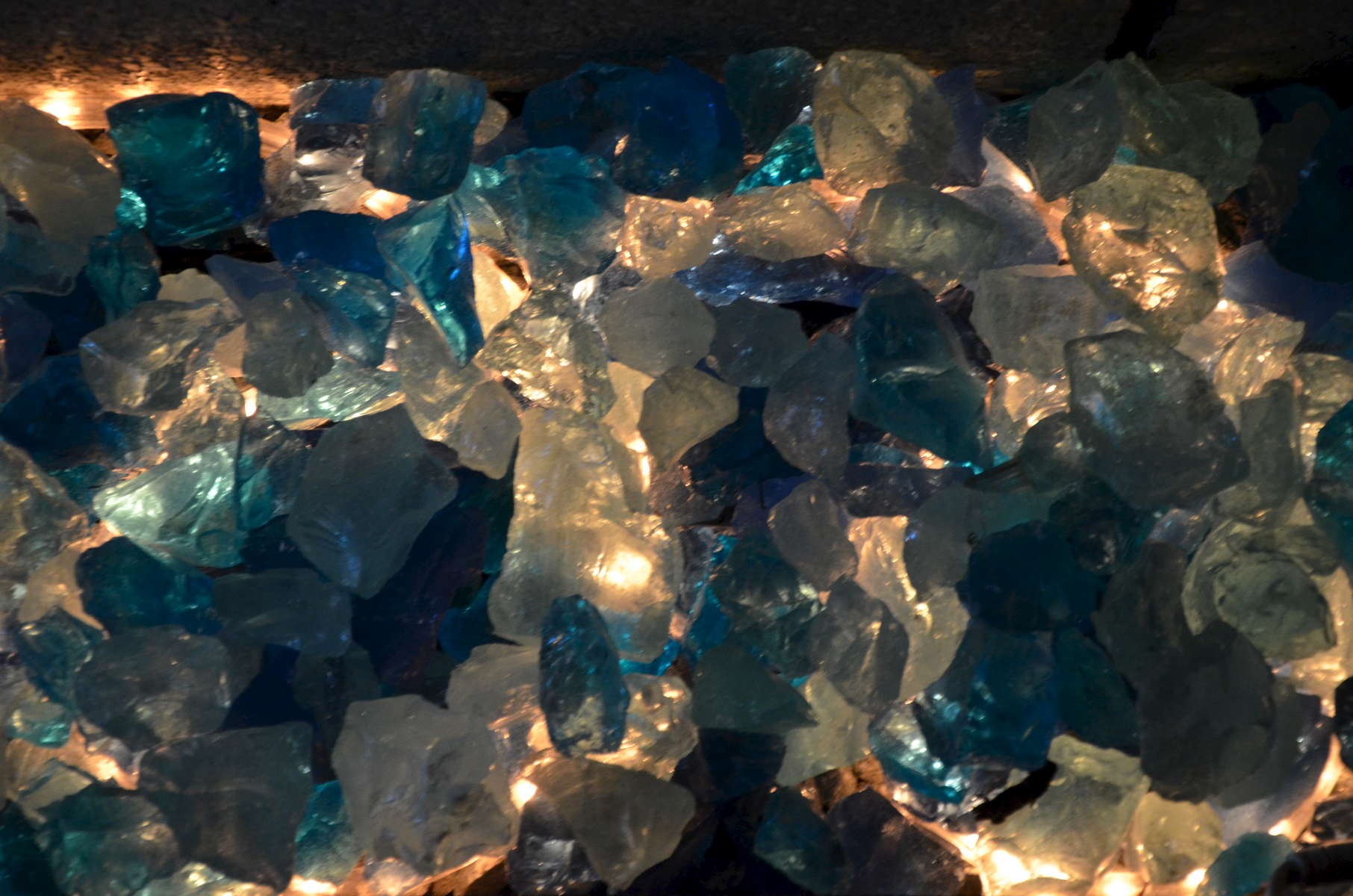 ...the blue glass block is creatively illuminated from underneath to increase the appeal of this unique landscape feature in the evening!