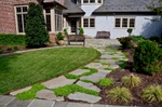 Enter friends & family; this tranquil meanering stepping stone path leads to the kitchen (side) entry of the residence. Culinary exploration is encouraged with the family's private herb garden located just steps away out the kitchen door...