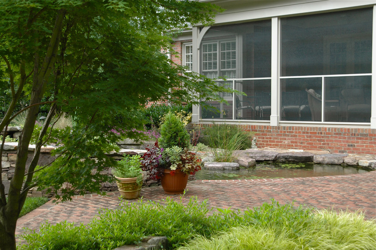 This once wide open backyard is now a place of refuge for these South Charlotte homeowners who enjoy time outdoors.