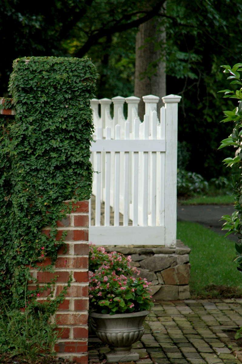 Custom picket fence on stone knee wall