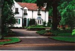 Solow Design Group transformed the grounds of this  traditional Myers Park home into an elegant English-inspired masterpiece.