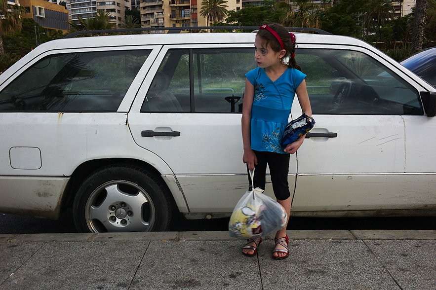 Young girl waiting for somebody outside the car, Beirut, May 2013