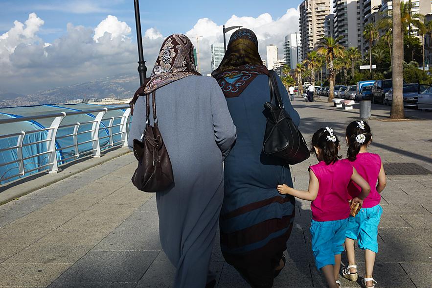 La Corniche, Identilcal twin gilrs walking, Beirut, May 2013
