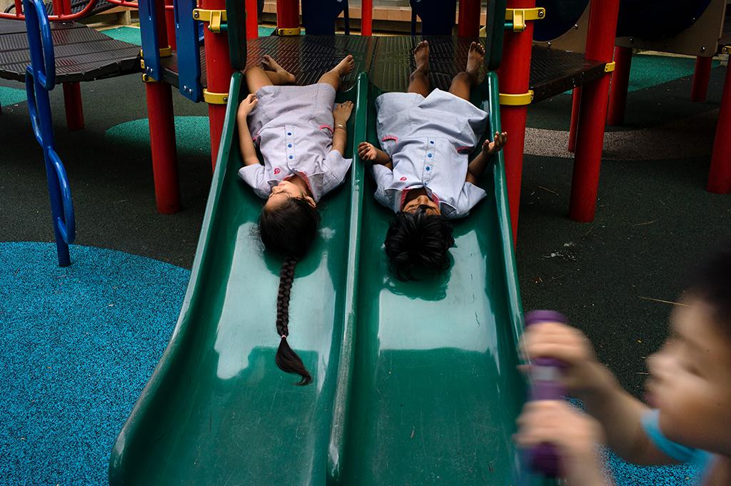 L1097226-Bishan-girls-upside-on-slide-for-FB
