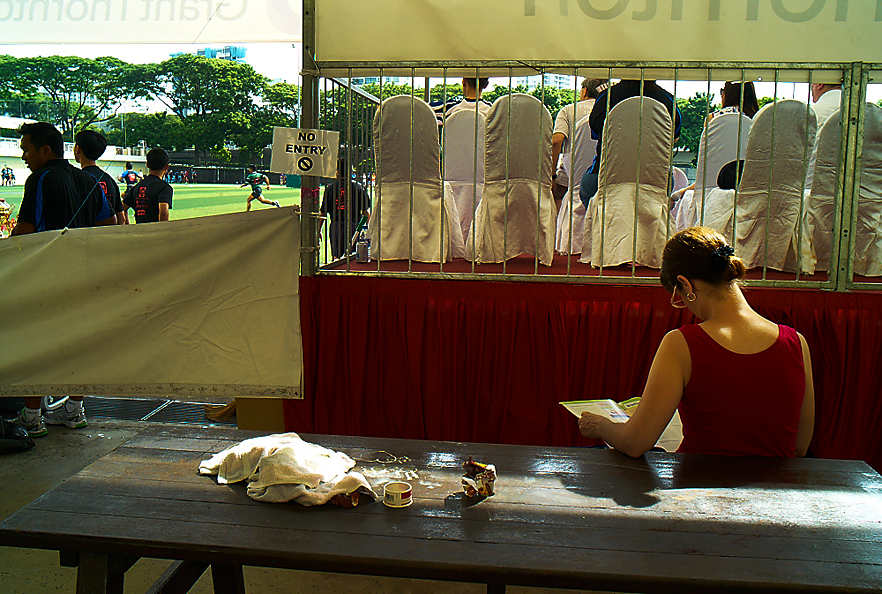 At St Andrew School, mother rests between games, 2012