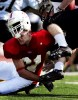 St. John's Kevin Boegel upends St. Olaf running back Cory Watkins during the second quarter in Collegeville, Minn.