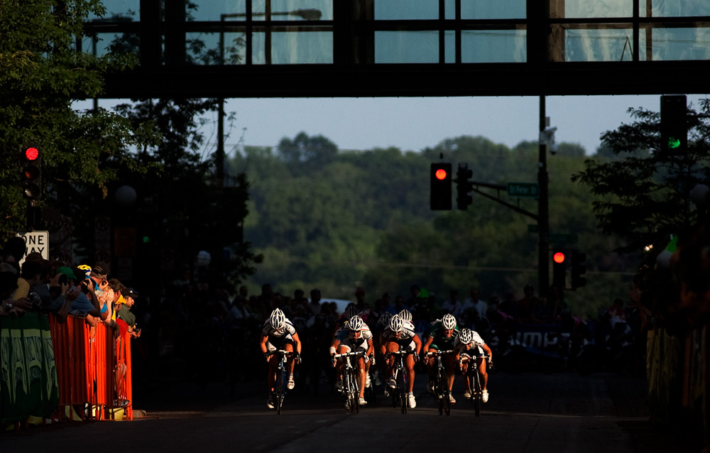 Riders speed toward the finish of the Nature Valley Grand Prix race through the streets of St. Paul, Minn.
