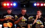 Amy Bergseth, right, of Chicago battles competitive eaters, from left, Bob Shoudt of Royersford, Pennsylvania, and Frank Wach of Chicago during the Goldenpalace.com World Grilled Cheese Eating Championship at the Illinois State Fair.