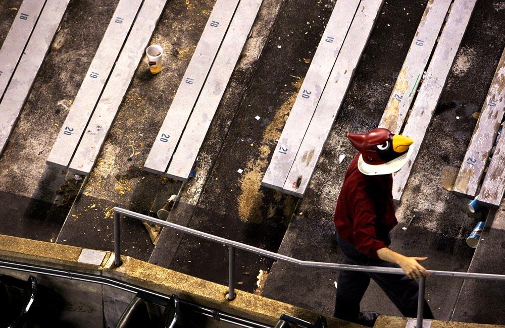 A supportive fan exits the bleacher section of Busch Stadium.