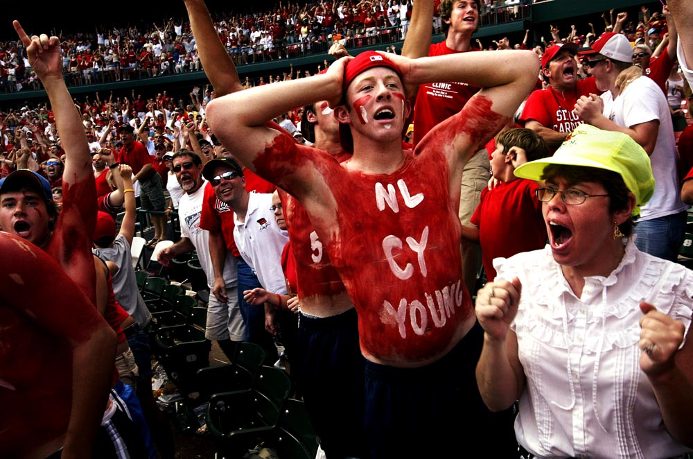 Fans, including Kyle Sanders, 18, of Millstadt, Ill., center, react after David Eckstein belts a ninth-inning grand slam over the fence at Busch Stadium to give the Cardinals the win over Atlanta.