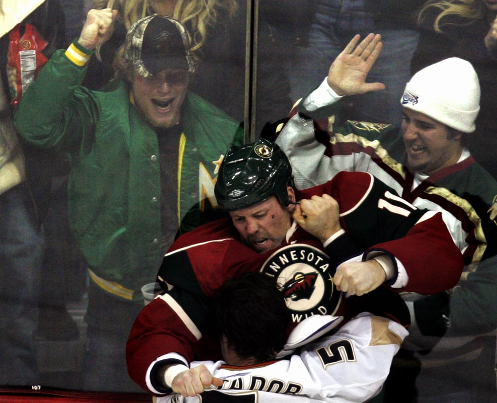 Fans cheered as Minnesota's Owen Nolan and Anaheim's Steve Montador fought during the second period in St. Paul, MInn.