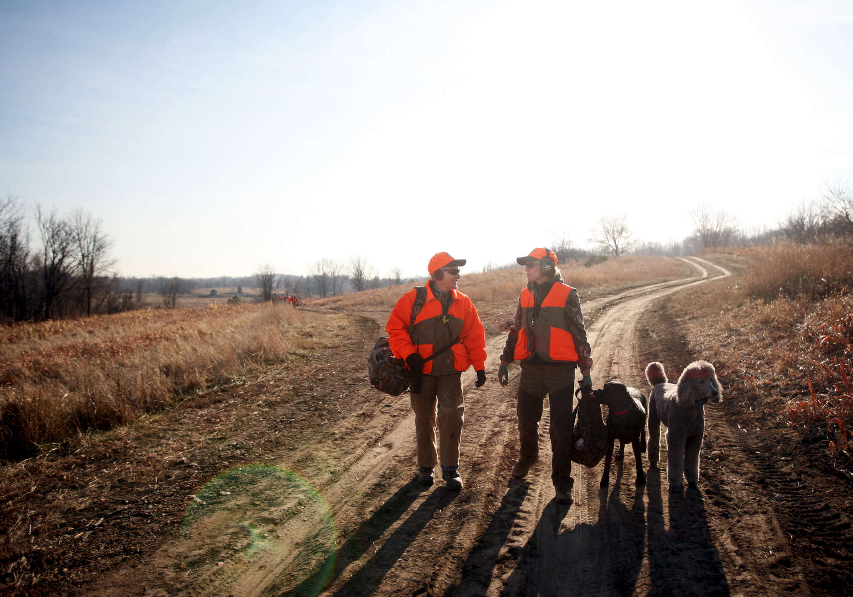 Lin Gelbmann, left, and Libbe Erickson attend a hunt at the Minnesota Horse and Hunt Club in Prior Lake with their dogs, including Mynx, a black lab, and Cache, a poodle. Gelbmann and Erickson have both been hunting with their poodles for years.