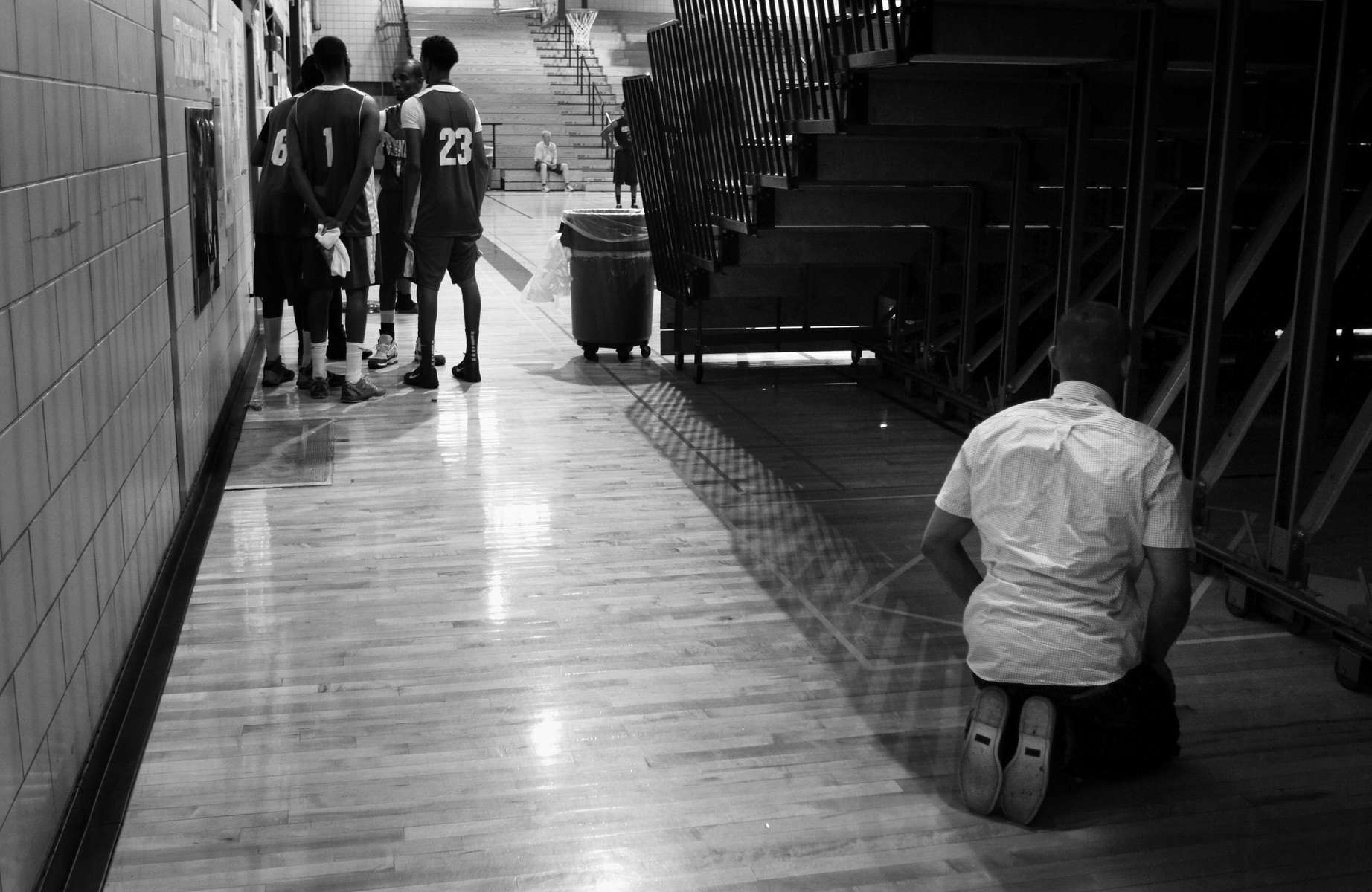 Minneapolis-based Somali Youth League player Omar Omar prays during the Hoop for Hope Somali Basketball League annual tournament at Roosevelt High School in Minneapolis.