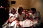 Sacred Heart second-graders review their instructions before entering the church for First Communion mass.