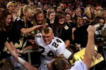 Calendonia's Ryan Goetzinger and his teammates celebrated with fans after their 44-13 win over Moose Lake-Willow River in the Minnesota state football tournament Class 2A semifinal game at the Metrodome.
