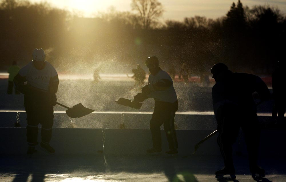 Players shovel their respective rinks before the first round of games of the U.S. Pond Hockey Championships on Lake Nokomis in Minneapolis, Minn. Over 1,400 players from more than 30 states and a three countries compete for the golden shovel.