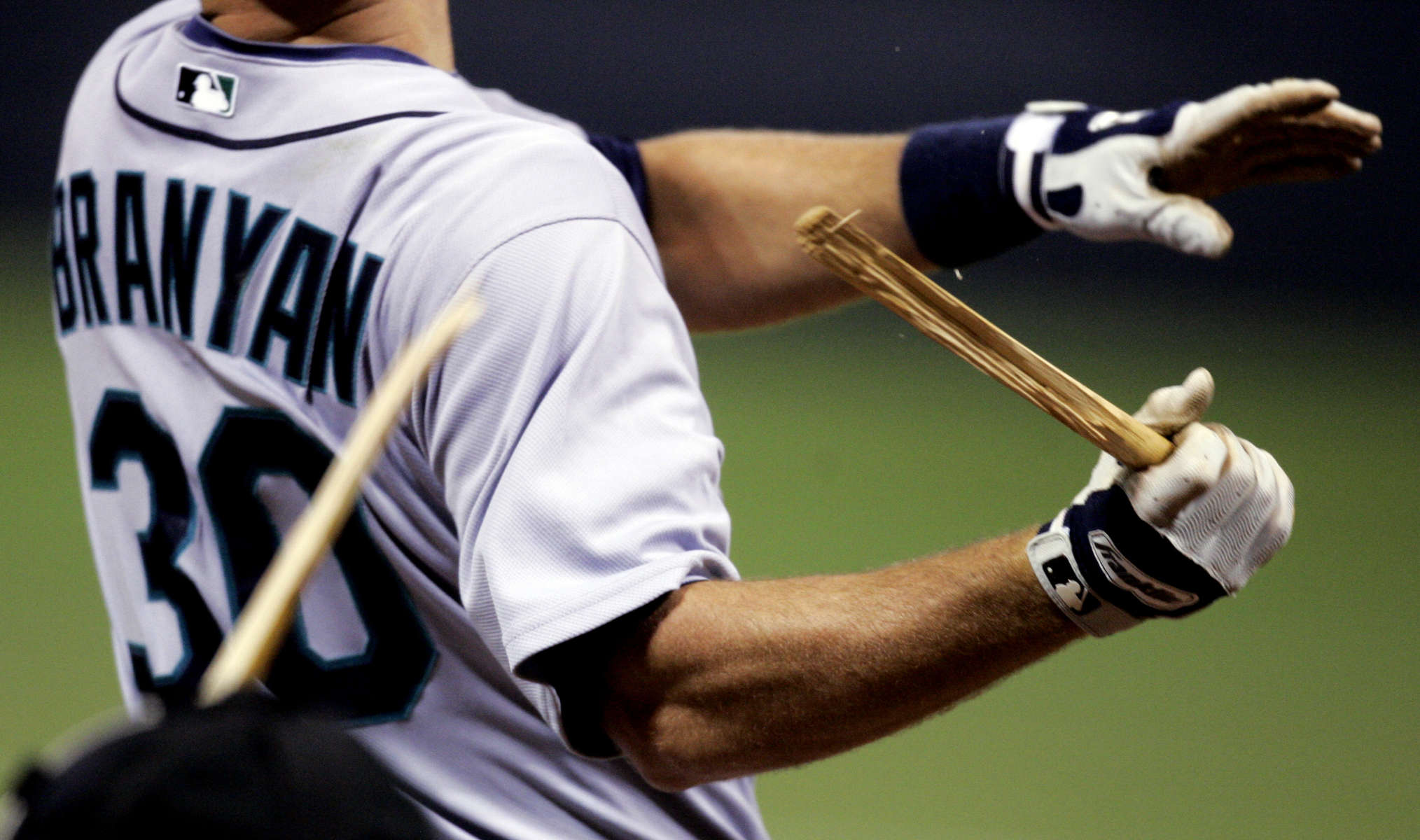 Seattle's Russell Branyan snaps his bat during the fifth inning during the Twins season opener in Minneapolis, Minn.