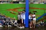 Cretin Derham-Hall fans find shelter at Midway Stadium during a storm delay during the Minnesota State Baseball championship game in St. Paul, Minn. Heavy rains and lightning ultimately forced the game to be postponed.